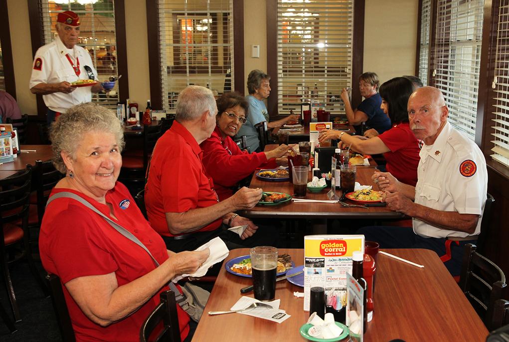 Members of the Marine Corps League eat a free dinner Monday evening. Jillian Danielson/RiverScene
