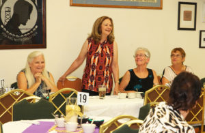 Kathy Sammons speaks to the Ladies Auxiliary Monday evening at a dinner. Jillian Danielson/RiverScene