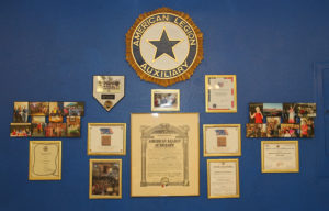 Auxiliary photos and plaques hang on the wall at the American Legion. Jillian Danielson/RiverScene