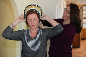 Amber Vanderjagt assists Melanie Preston with a hood that was made by Tina Harrison. Jillian Danielson/RiverScene