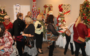 Attendees look at the trees that were raffled off Sunday afternoon. Jillian Danielson/RiverScene