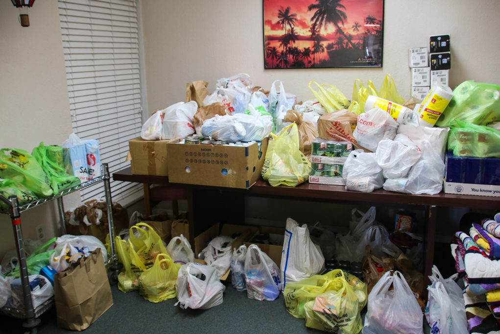food tables were full of food for the food bank. Rick Powell/RiverScene