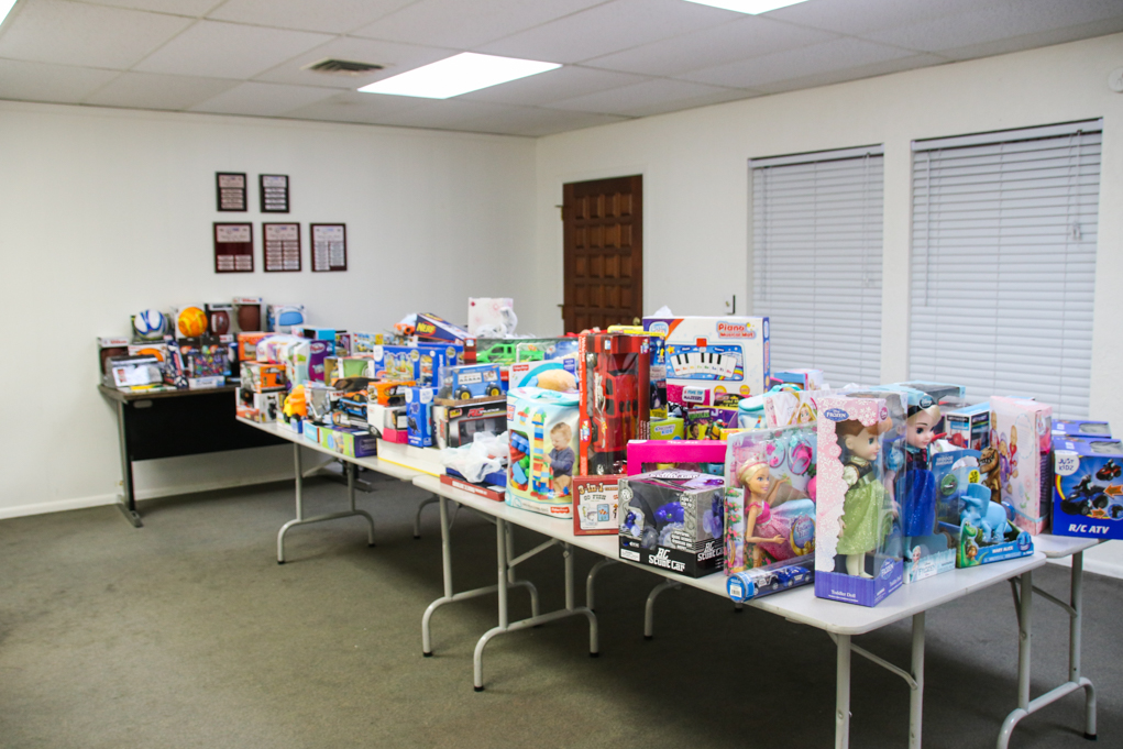 Tables were full of toys at todays Inter Angency toy and food drive. Rick Powell/RiverScene