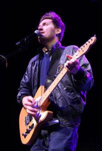 Jesse Pruett plays guitar at Calvary Baptist Church. Jillian Danielson/RiverScene