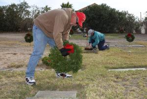 Paul Roe Sr. places a wreath on a Veteran's grave site Wednesday morning at Havasu Memorial Gardens. Jillian Danielson/RiverScene