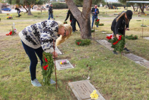 Suzanne Mike and Stephanie Finch place a wreath on a Veteran's grave site Wednesday morning at Havasu Memorial Gardens. Jillian Danielson/RiverScene
