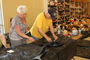 Toni Pyatt and John Johnston prepare bags for the toys Tuesday afternoon. Jillian Danielson/RiverScene