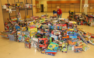 Toys sit in age groups to be bagged for families. Jillian Danielson/RiverScene