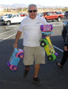 Randy Kelso carries toys into the Toys For Tots shop Tuesday afternoon. Jillian Danielson/RiverScene