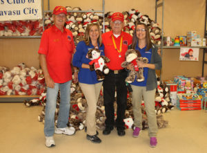 Represenatives from the Marine Corps League and Petsmart pose for a photo with donated toys Tuesday afternoon. Jillian Danielson/RiverScene