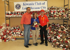 Representatives from Kiwanis, Petsmart, and the Marine Corps. League pose for a photo with donated toys Tuesday afternoon. Jillian Danielson/RiverScene