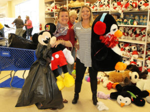 Representatives from the Chamber of Commerce pose for a photo while bagging toys Tuesday afternoon. Jillian Danielson/RiverScene