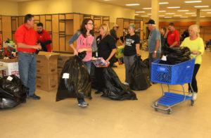 Volunteers bag their toys Tuesday afternoon for families. Jillian Danielson/RiverScene