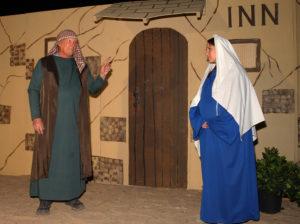 Bob Broadie and Sarah Myhre pose in the Innkeeper scene during the Live Nativity. Jillian Danielson/RiverScene