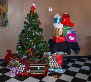 Toys for the kids sit under the tree at Pennington's Pub Sunday. Rick Powell/RiverScene