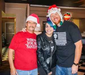 Organizers of the benefit Rick Powell and Jerad Pennington pose for a photo with Destiny Jurado Sunday at the benefit.