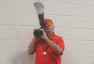 Ron Silva shoots photos at an event. Judy Lacey/RiverScene