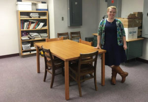 Kathleen Stengel stand in a room that will soon be transformed into a pantry for students. Photo RSM Team