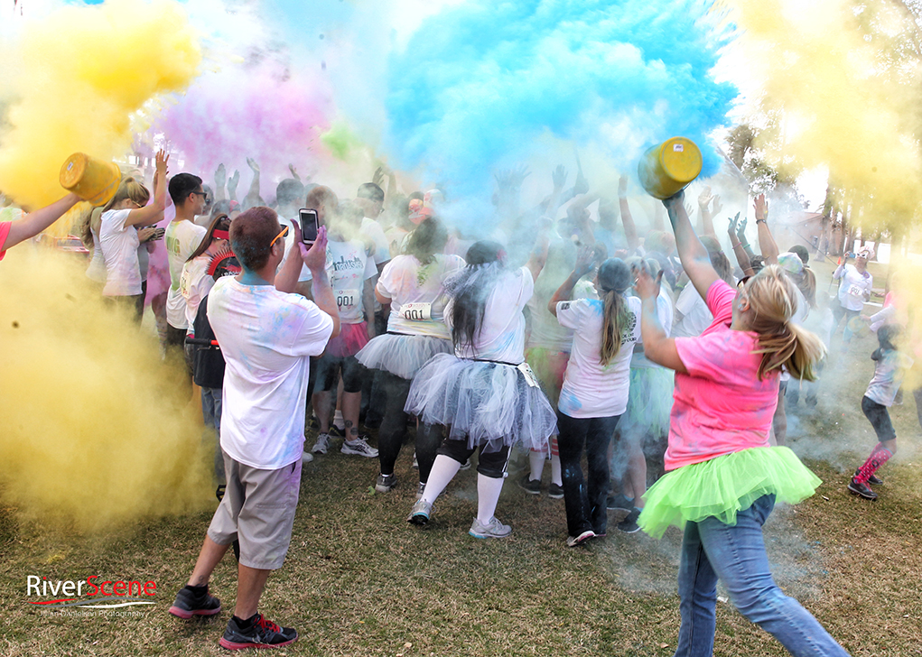 Runners participate in a color bomb after the race Saturday morning  Jillian Danielson/RiverScene