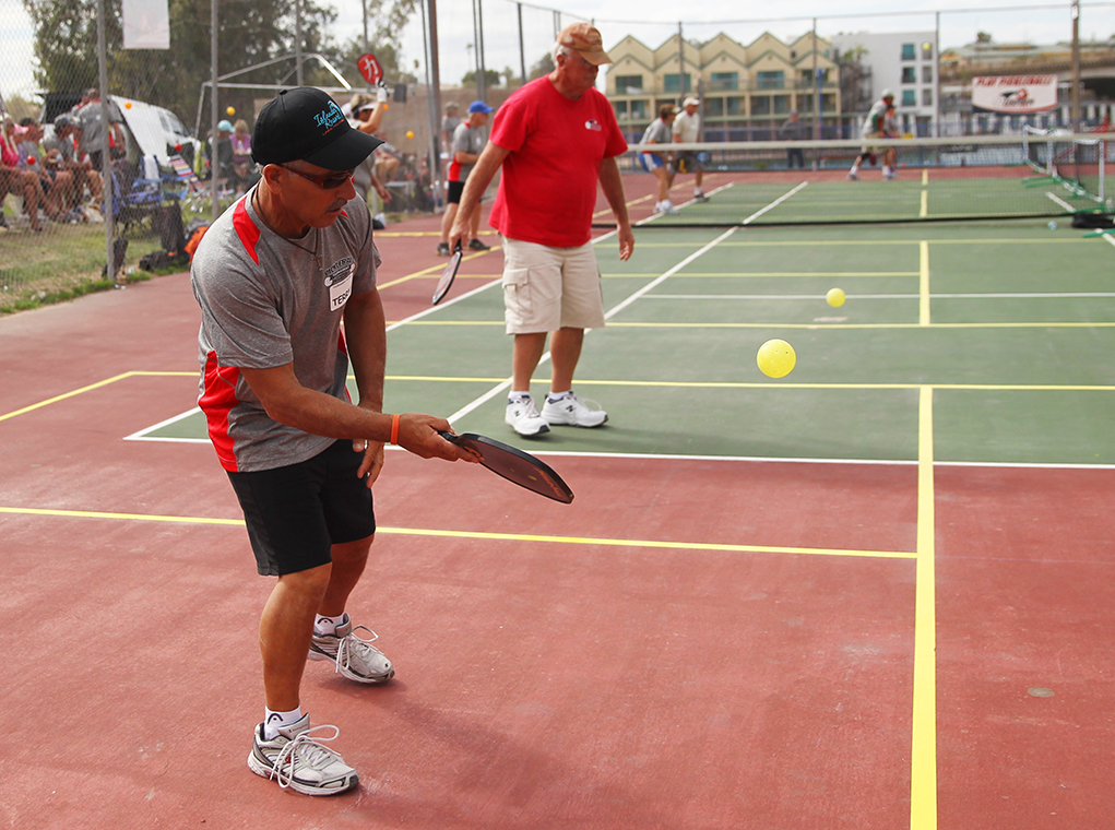 Terry Cameron and Roger Will play Pickleball Saturday afternoon in a tournament. Jillian Danielson/RiverScene