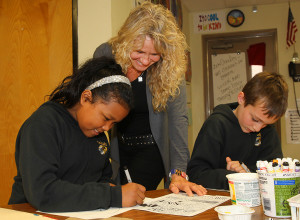 Pam works with students  Aisha Osman and A.J. Yahn on their Zen Doodles. Jillian Danielson/RiverScene
