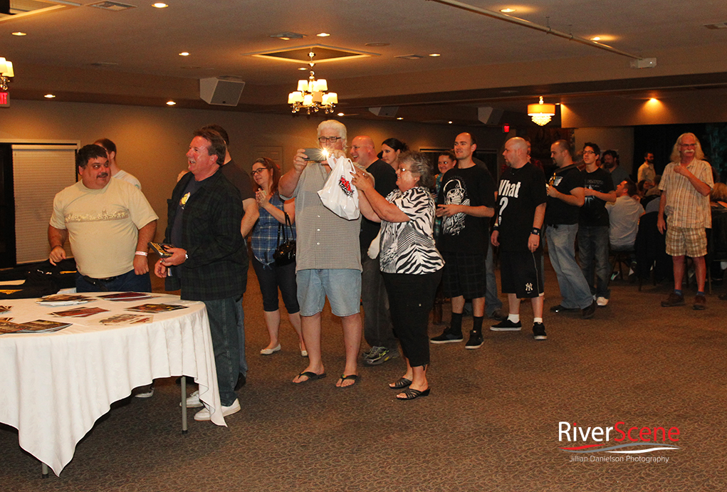 Fans line up for autographs with Mick Foley at a comedy night sponsored by Pennington's Pub at the London Bridge Resort.