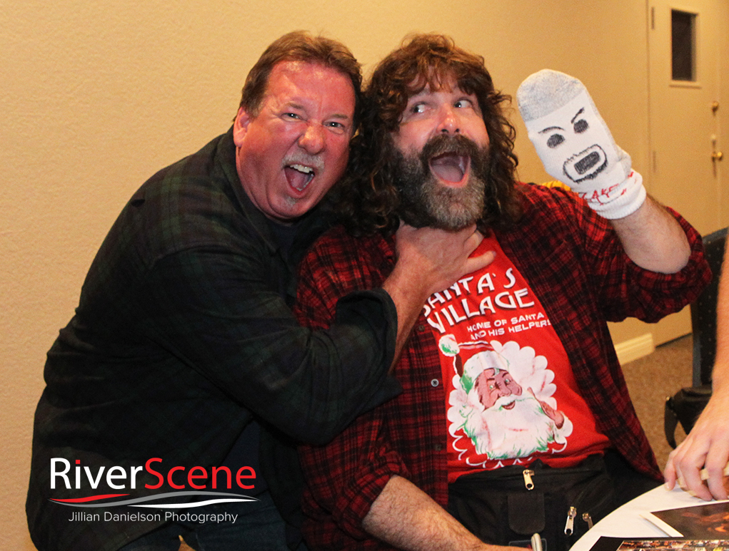 A fan gets his photo with Mick Foley Saturday evening at London Bridge Resort.