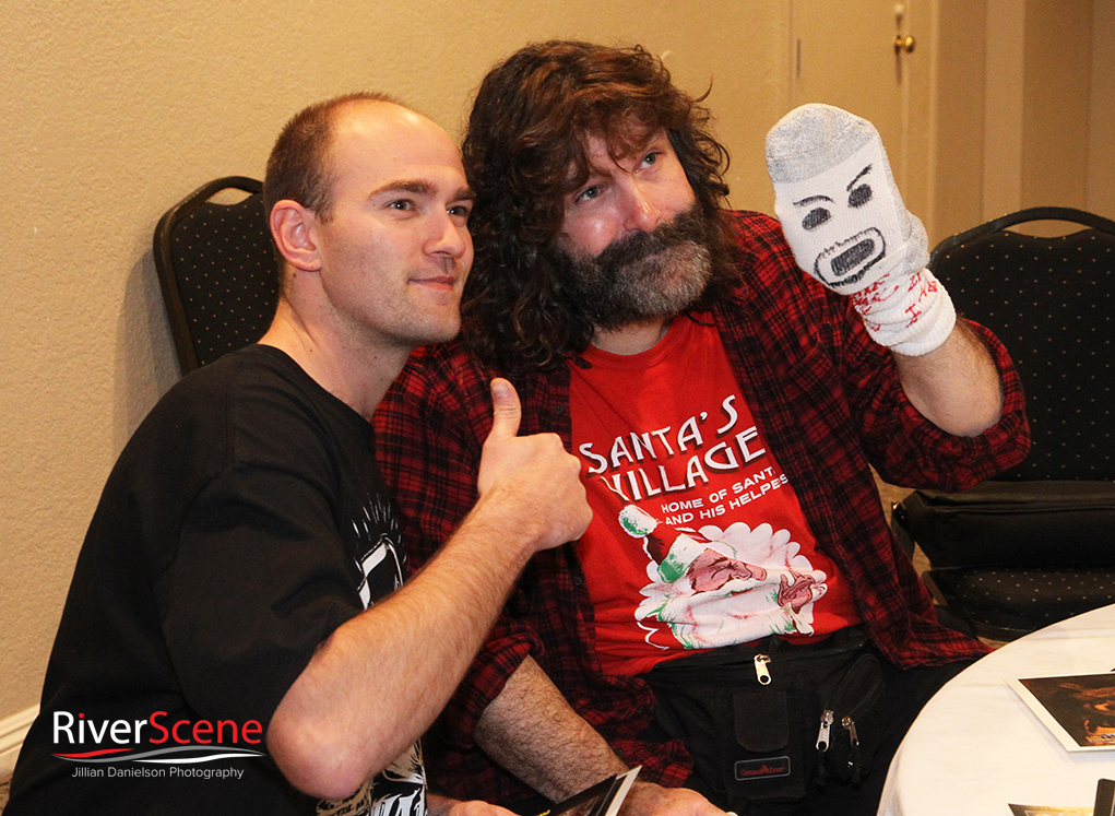 A fan gets his photo with Mick Foley Saturday evening.