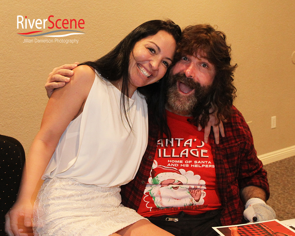 A fan poses in a photo with Mick Foley Saturday evening during a meet and greet.