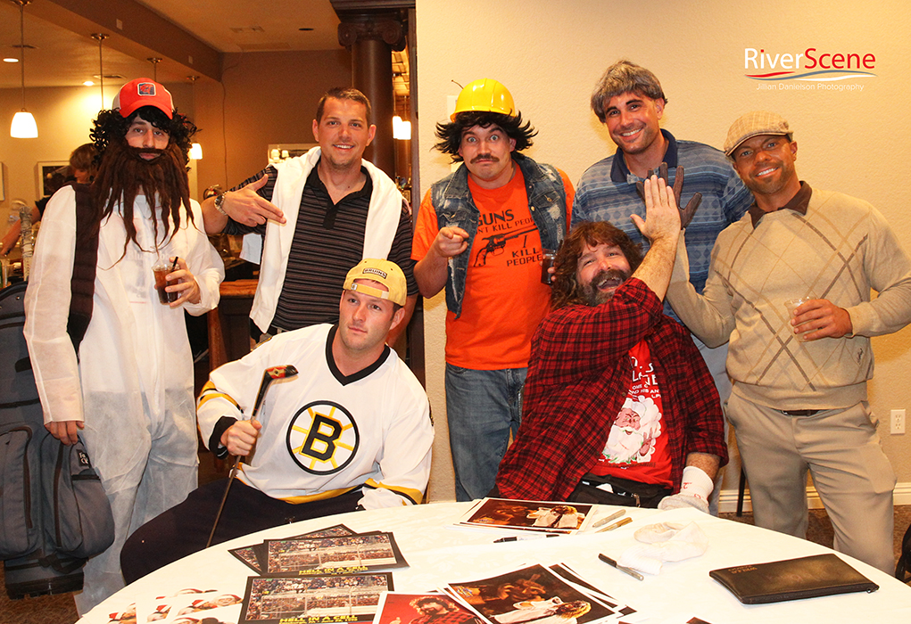 """A group dressed as the characters from """"Happy Gilmore"""" pose with Mick Foley Saturday evening at the London Bridge Resort. The group was celebrating Patrick Larson's birthday."""