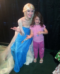 Maisy Samuelson , dressed as Queen Elsa, poses with a child during a Christmas event at Tranquility.  Submitted photo by Heather Pace
