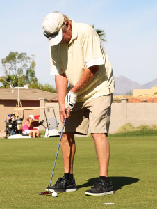 Bob Farrell putts during the Military Moms Golf Tournament. Jillian Danielson/RiverScene