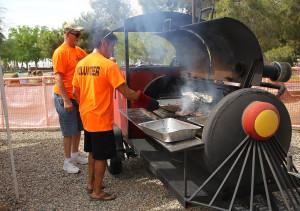 Volunteers cook burgers for the Teens at Teen Break. Jillian Danielson/RiverScene