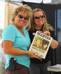 Lyn Demarat poses with Marquita McKnight and her Wanted poster at the Jail-A-Thon. Jillian Danielson/RiverScene