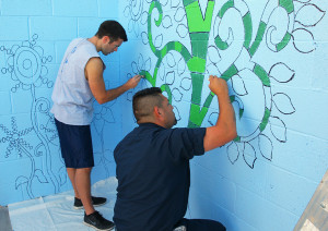 Steve Filmer and Ray Apalategui paint on a wall at HAVEN Saturday morning.