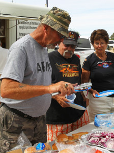 """""""Weird Harold"""" , Wendell and Judy Shirk stand in line for their  burgers at the Vietnam Veteran's BBQ Sunday afternoon. Jillian Danielson/RiverScene"""