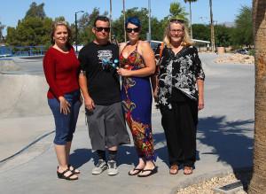 Jennifer Black, Paul and Jamie Crutcher, and Cindy Aker visit Daniel's plaque at the Tinnel Sportspark Saturday. Jillian Danielson/RiverScene