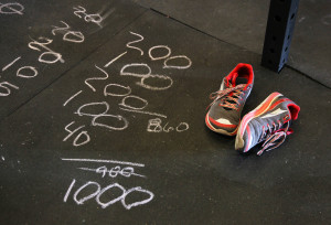 Burpees by the 100s are drawn on the floor to help keep track on how many to do. Jillian Danielson/RiverScene