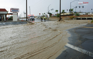A parking lot fills with water during a storm on July 13, 2012. Jillian Danielson/RiverScene