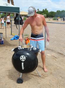 Branden Smith grills at Rotary Beach Saturday morning.