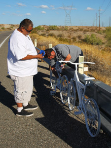 Anthony Martinez and Junior Villafana secure the bikes to a guardrail Wednesday afternoon. Jillian Danielson/RiverScene