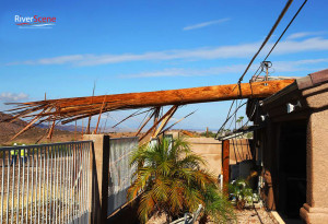 A telephone pole lies on a house after a microburst hit the southside of Lake Havasu on August 3, 2014. Jillian Danielson/RiverScene