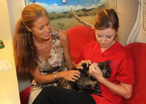"Bonnie Butterworth and Samantha Dahl hold ""Lucky"" at the Humane Society. Jillian Danielson/RiverScene"