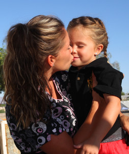 Cindy Williams kisses her daughter, Kennah, good luck on her first day of kindergarten at Starline Elementary. Jillian Danielson/RIverScene
