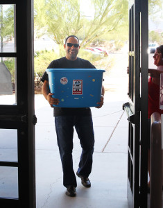 Chad Nelson of Keller Williams carries school supplies into Thunderbolt Middle School Friday morning. Jillian Danielson/RiverScene
