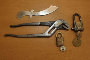 A letter opener, wrench used by Naylor, and locks. Jillian Danielson/RiverScene