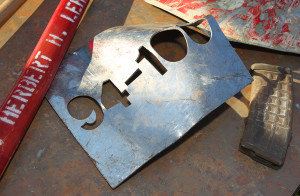 A plate from a World Trade Center elevator sits on display Friday morning during the 9/11 ceremony at London Bridge Beach. Jillian Danielson/RiverScene