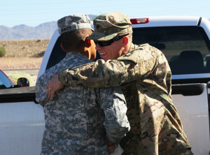 SPC Justin Penikas hugs SSgt. Miguel Montes Saturday morning at the Welcome Home Ceremony. Jillian Danielson/RiverScene