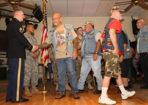 SSGT. Devon Neir gets a hand shake from American Legion Riders Saturday morning. Jillian Danielson/RiverScene