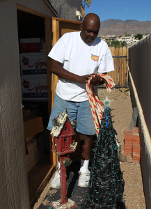 Tee Taylor gets Christmas decorations out of his storage to prepare his yard. Jillian Danielson/RiverScene